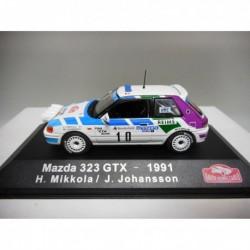 MAZDA 323 GTX RALLY MONTE CARLO 1991 H.MIKKOLA n28 ATLAS IXO 1/43